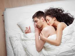 Spooning couple sleeping position